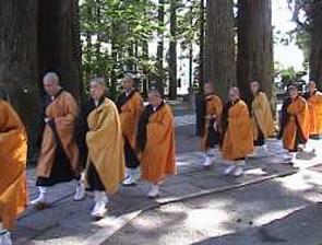 Buddhist Priests Walking to a Prayer Service